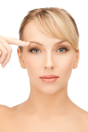 face of beautiful woman pointing at her eyebrow Stock Photo - 19857275