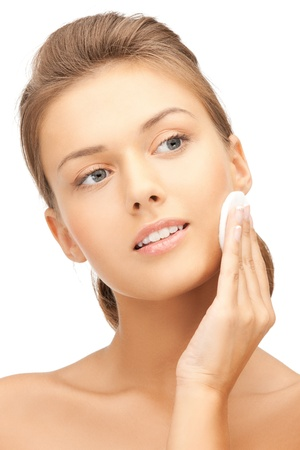 facial cleansing: bright picture of beautiful woman with cotton pad