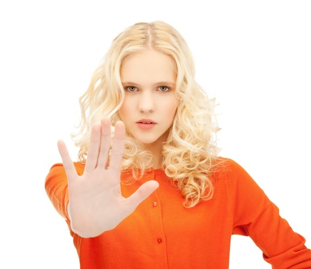 mistrust: bright picture of young girl making stop gesture   Stock Photo