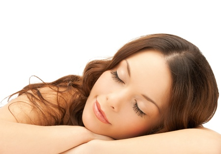 beautiful woman with long eyelashes in spa photo