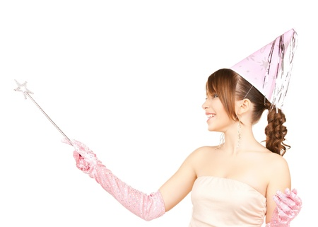 fairy woman: happy girl in party cap with magic stick Stock Photo