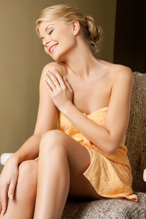 picture of happy woman sitting in spa photo