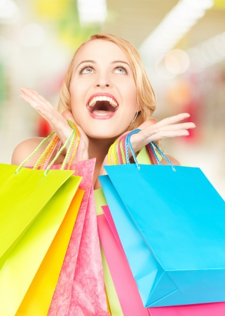 picture of happy woman with shopping bags photo