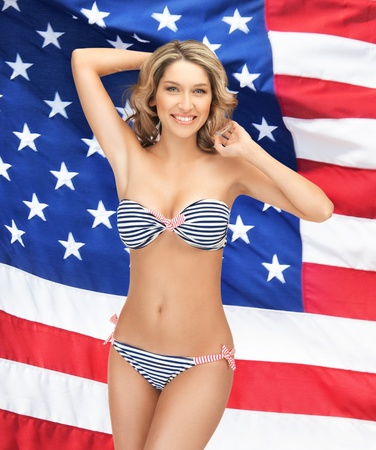 picture of beautiful smiling woman in bikini over american flag photo