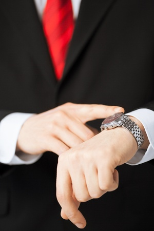 close up of man looking at wristwatch photo