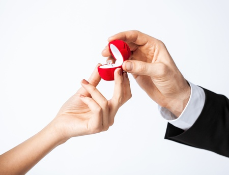 proposal: couple hands with wedding ring and gift box  Stock Photo