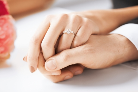 ring wedding: picture of man and woman with wedding ring