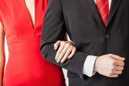 couple with wedding ring holding each other hands photo