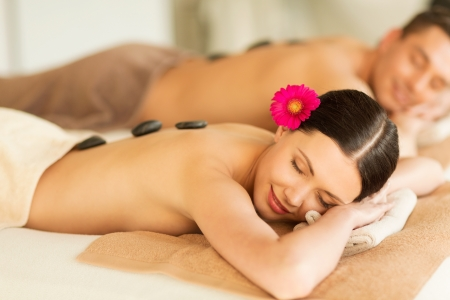 hot rock therapy: picture of couple in spa salon with hot stones