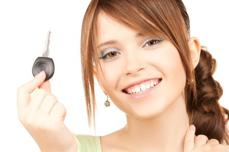 auto leasing: bright picture of smiling girl with car key