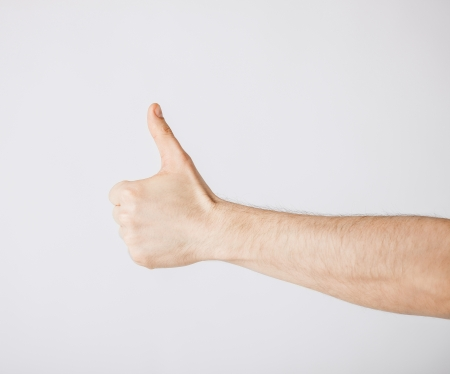 close up of man hand showing thumbs up Stock Photo - 20019536