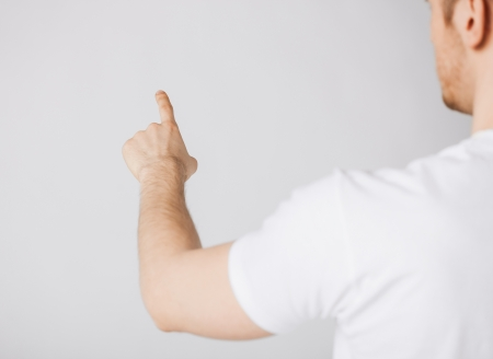 picture of man hand pointing at something photo