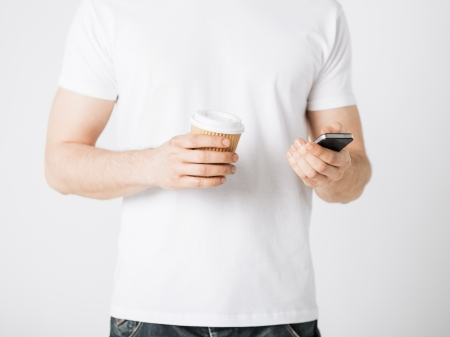 man with smartphone and take away coffee cup Stock Photo - 20019509