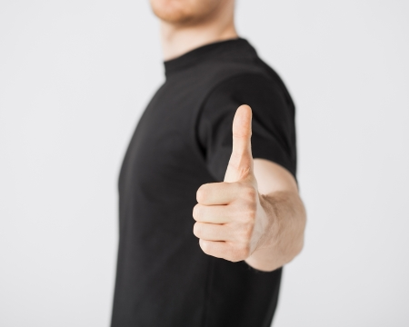 close up of man hand showing thumbs up Stock Photo - 20019505