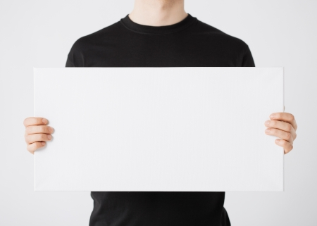 by hand: close up of man hands showing white blank board Stock Photo