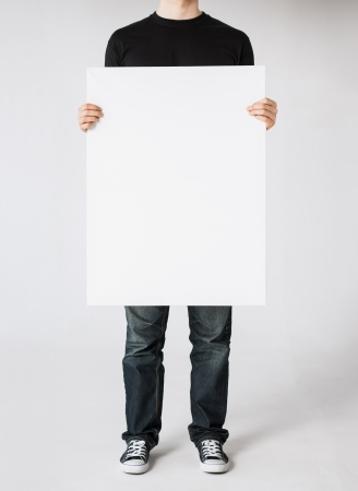 blank poster: close up of man hands showing white blank board Stock Photo