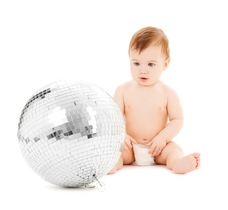 bright picture of happy child playing with disco ball photo