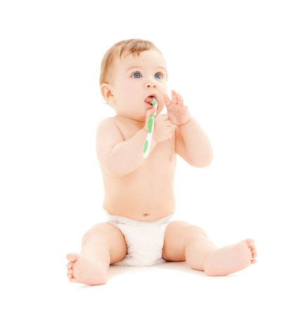 dentistry: bright picture of curious baby brushing teeth