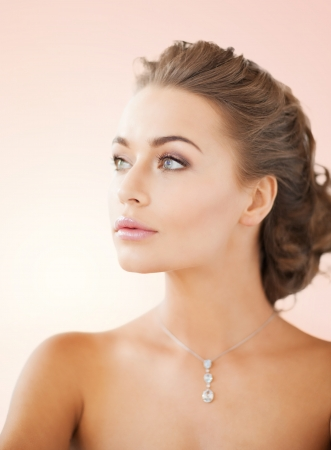close up of beautiful woman wearing shiny diamond necklace Stock Photo - 20019497