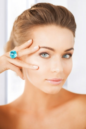 ear rings: picture of beautiful woman with one jewelry ring Stock Photo