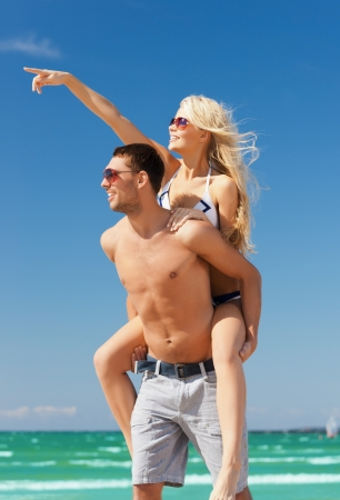 picture of happy couple having fun on the beach photo