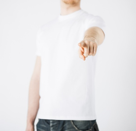 criticising: close up of man pointing his finger at you