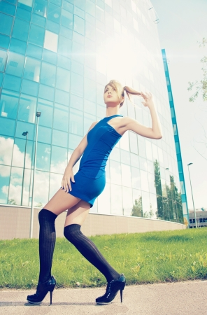 fashion top model posing outside on high heels photo