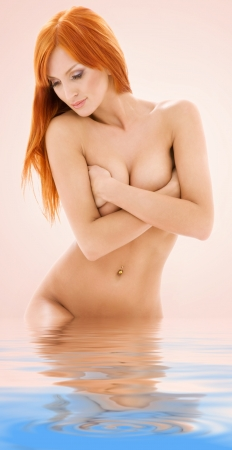 aqua naked: bright picture of healthy naked redhead