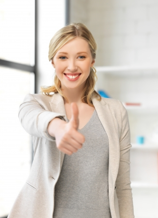ok hand: bright picture of young woman with thumbs up