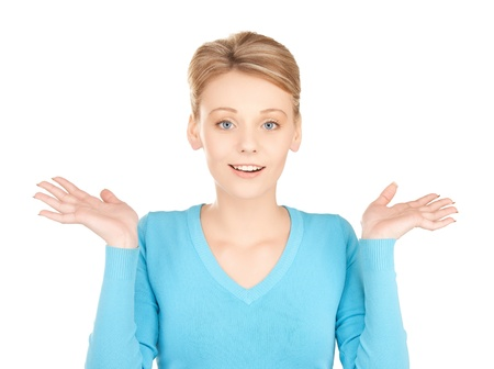 picture of playful unsure woman shrugging or doubting photo