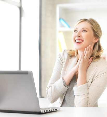 woman sitting with laptop: bright picture of happy woman with laptop computer