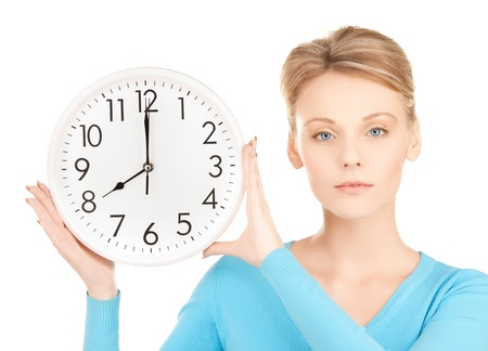 running out of time: picture of attractive businesswoman with wall clock Stock Photo