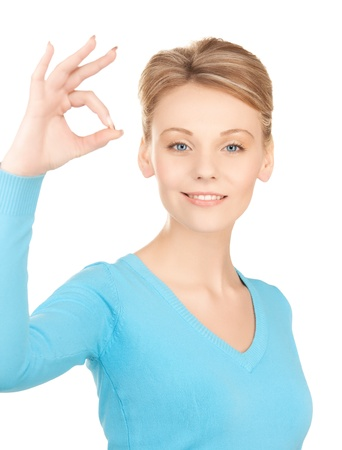 bright picture of young woman showing ok sign Stock Photo - 20021215