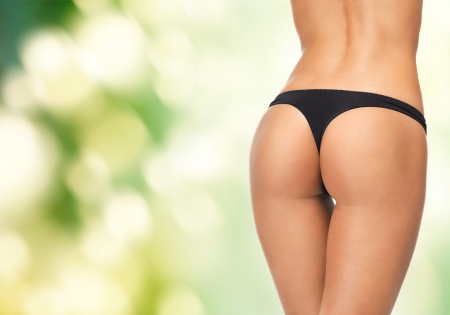perfect female body: picture of female legs in black bikini panties Stock Photo