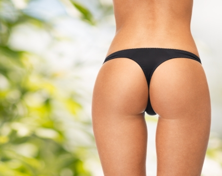 picture of female legs in black bikini panties Stock Photo