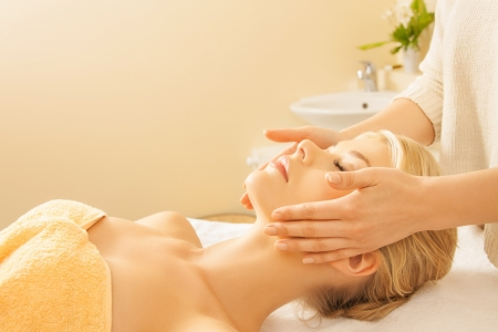 close up of woman in spa salon getting face treatment photo