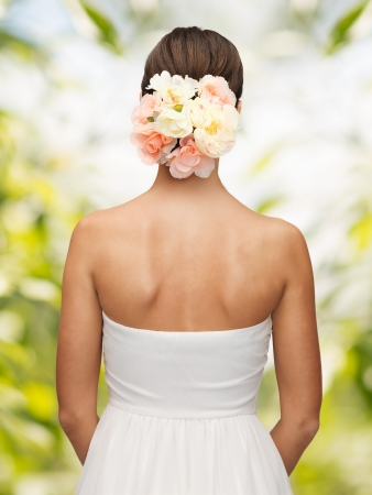 close up of woman with flowers in her head photo
