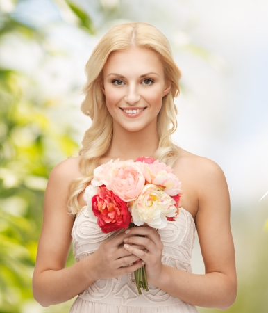 nude bride: close up of young woman with bouquet of flowers Stock Photo
