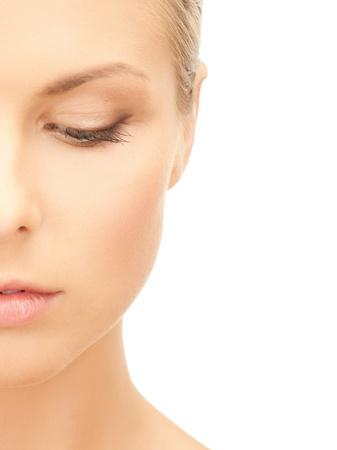 portrait of half face of beautiful woman photo