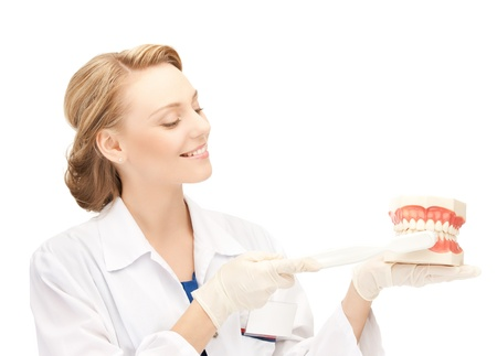 stomatologist: smiling female doctor with big jaws and toothbrush