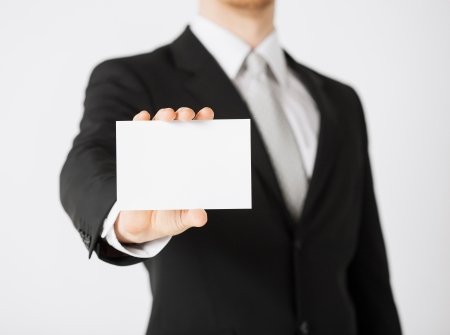 picture of man hand with blank paper photo
