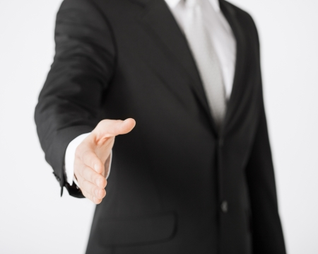 businessman with open hand ready for handshake photo