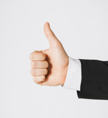 close up of businessman hand showing thumbs up Stock Photo - 20074754