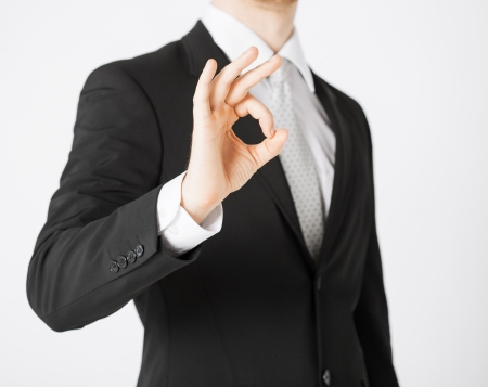 bright picture of man hands showing ok sign Stock Photo - 20074884