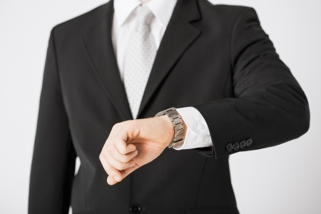 rushing hour: close up of man looking at wristwatch  Stock Photo