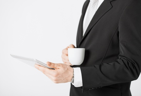 close up of man with tablet pc and cup of coffee Stock Photo - 20074856