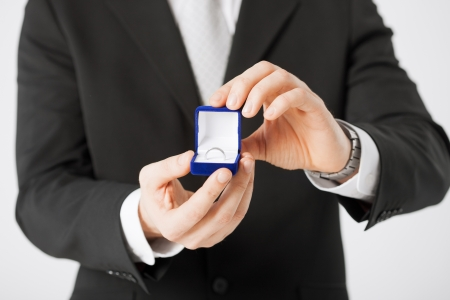 jewel box: picture of man with gift box and wedding ring