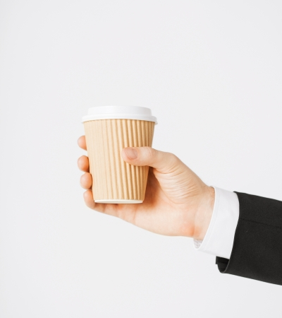 man hand holding take away coffee cup photo