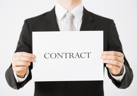 picture of man hands holding contract paper photo