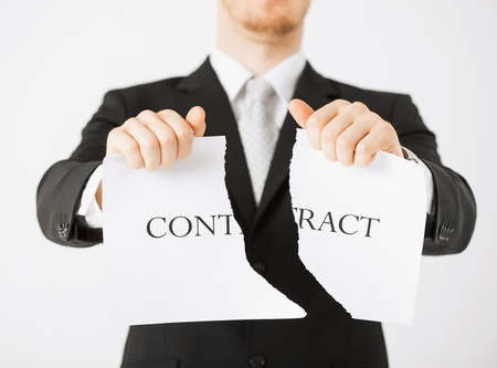 municipal utilities: picture of man hands tearing contract paper